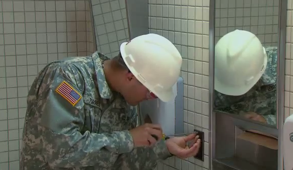 military electrician replacing receptacle